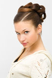 Hairstyle. Young woman on gray with hairstyle Stock Images