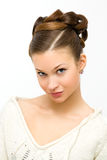 Hairstyle. Young beauty woman on gray with hairstyle Stock Images