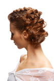 Hairstyle. Close-up bridal hair young beautiful brunettes on a white background Royalty Free Stock Photos