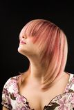 Hairstyle. A photo of attractive woman with straight dyed hair Royalty Free Stock Photography