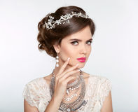 Hairstyle. Attractive girl with makeup. Jewelry Earring. Express Royalty Free Stock Photography