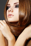 Hairstyle. Beautiful model with long shiny hair Stock Photos