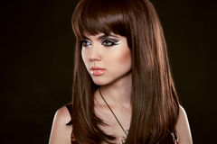 Hairstyle. Beautiful woman with long healthy brown hair.  Isola Stock Image