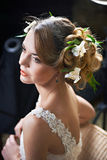 Hairstyle beauty girl woven with flowers lily Royalty Free Stock Photos