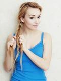 Hairstyle. Blond woman teenage girl plaiting braid hair. royalty free stock photos