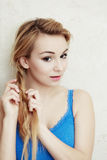 Hairstyle. Blond woman teenage girl plaiting braid hair. Royalty Free Stock Photos