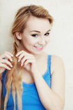 Hairstyle. Blond woman teenage girl plaiting braid hair. Royalty Free Stock Images