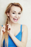 Hairstyle. Blond woman teenage girl plaiting braid hair. Royalty Free Stock Photography