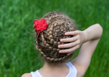 Hairstyle with braids on a young girl Royalty Free Stock Photo