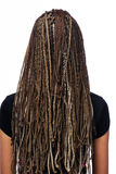 Hairstyle dreadlocks. Rear view of  hairstyle dreadlocks - girl isolated on white Royalty Free Stock Photos