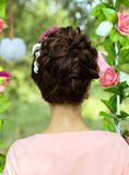 Hairstyle girl, background with back in the nature Stock Photography