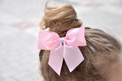 Hairstyle with a girl bow royalty free stock image