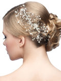Hairstyle with hair accessory. Portrait of attractive young woman with beautiful hairstyle and stylish hair accessory, rear view Stock Photography