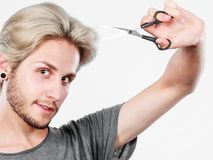 Man with scissors ready to hair cutting Stock Image
