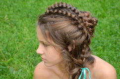 Hairstyle with long hair. Creative weaving stock photography