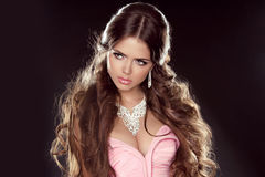 Hairstyle. Long Hair. Fashion Beautiful Girl Model with Jewelry Stock Photo