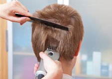 Hairstyle machine, kind in the rear Stock Photos