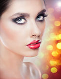 Hairstyle and Make up - beautiful female art portrait with beautiful eyes. Elegance. Genuine Natural brunette in studio. Portrait of a attractive woman with Royalty Free Stock Photos