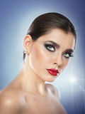 Hairstyle and make up - beautiful female art portrait with beautiful eyes. Elegance. Genuine natural brunette in studio. Portrait of a attractive woman with Royalty Free Stock Photo
