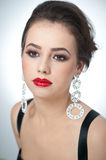 Hairstyle and make up - beautiful female art portrait with earrings. Elegance. Genuine natural brunette with jewelry Stock Photos