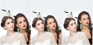 Hairstyle and make up - beautiful females art portrait. Elegance. Genuine natural brunettes with accessories in studio. Portrait of two attractive women with Stock Photos