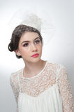 Hairstyle and make up - beautiful young girl art portrait. Cute brunette with white cap and veil, studio shot. Attractive girl Royalty Free Stock Images