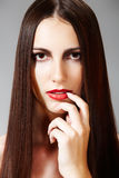 Hairstyle & make-up. Model with shiny long hair Stock Images