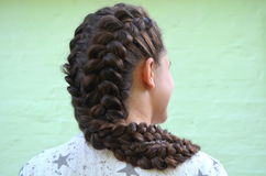 Hairstyle on medium length. Hairstyle braiding on medium length royalty free stock images