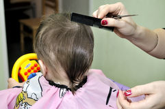 Hairstyle one year old child. Hairstyle of the one year old child Royalty Free Stock Photography