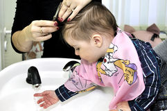 Hairstyle of the one year old child. Hairstyle of one year old child Royalty Free Stock Image
