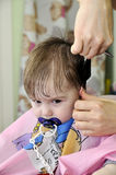 Hairstyle of the one-year-old child first time. Hairstyle one-year-old child first time Royalty Free Stock Photo