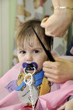 Hairstyle of the one-year-old child first time. Hairstyle one-year-old child first time Stock Image