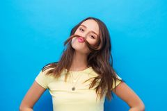Young woman making mustache with her hair stock photos