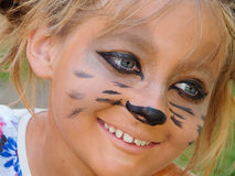 Hairstyle Points childhood joy holiday. Muzzle meerkat masquerade glasses on drawing the face child Stock Photo