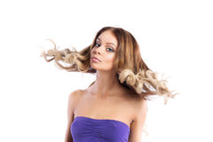 Hairstyle. Portrait of woman with flying hair. Royalty Free Stock Image