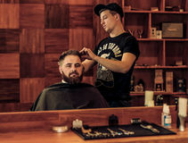 Hairstyle process in a man's Barbershop stock photos