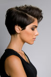 Hairstyle profile. Fashion model with straight short hair profile view Royalty Free Stock Images