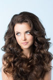 Hairstyle. Woman with wavy hair. Portrait of a beautiful young woman with wavy hair. Hairstyle Stock Photo