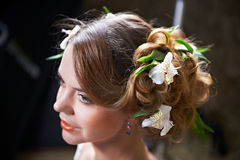 Hairstyle woven with flowers lily Royalty Free Stock Photography
