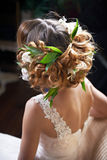 Hairstyle woven with flowers lily Stock Photos