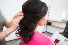 Hairstyle of young woman with curly dark hair Stock Image