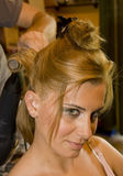 Hairstyling. Bride being hairstyling for her big day stock image
