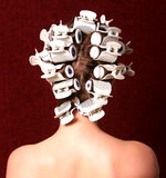 Hairstyling with hair rollers Stock Images