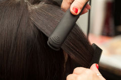 Hairstyling, Straightening Stock Images