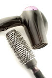 Hairstyling tools. Salon hair dryer and bristle brush for hairstylling Royalty Free Stock Image
