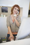 Hairstylist Answering Telephone At Reception Desk Stock Photography