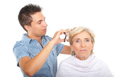 Hairstylist with client in beauty salon stock photography