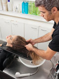 Hairstylist With Client Preparing For Hair Wash Royalty Free Stock Images
