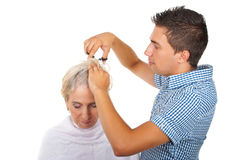 Hairstylist cut woman hair stock photography