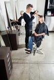 Hairstylist Cutting Customer's Hair In Salon Stock Photos
